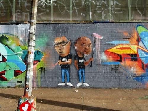 Photo of graffiti depicting two painters, taken at 5Pointz by Joana Miranda