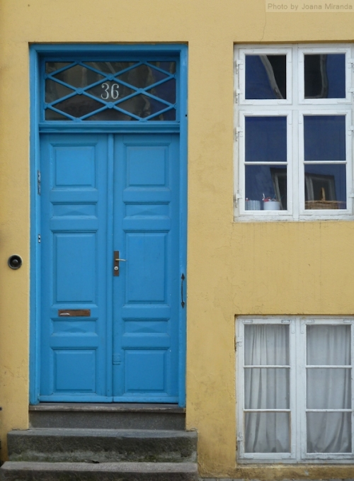 Blue door yellow wall