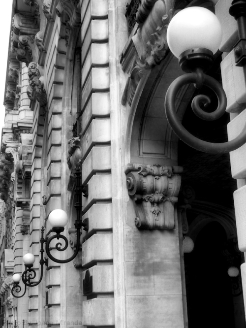 Black and white photograph of Art Deco building with globe lanterns