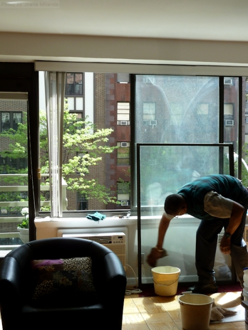 Windows in a NY apartment being cleaned