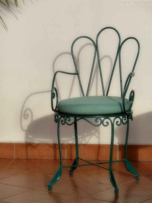 green chair on red tile floor