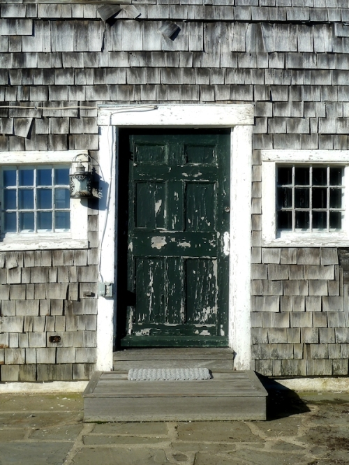 Green weathered door in Nantucket