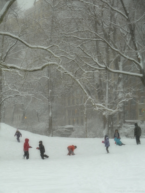 children playing in the snow.