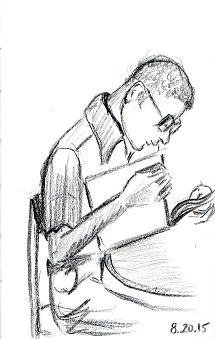 studious man reading at the library