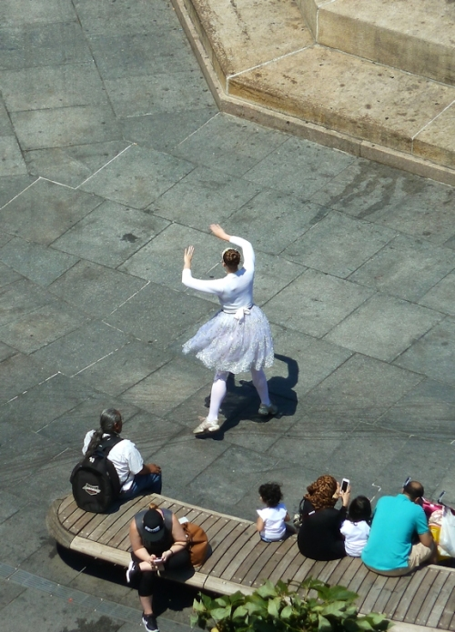 woman dancing in white tutu
