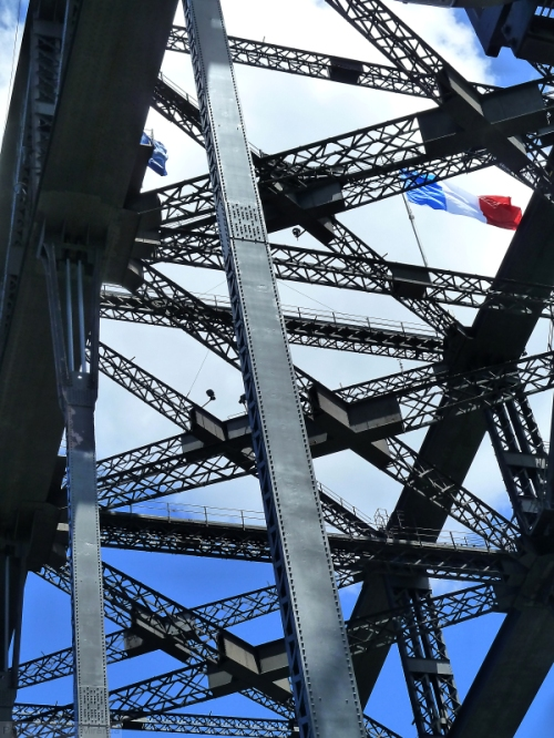 French flag over the Sydney Harbor Bridge