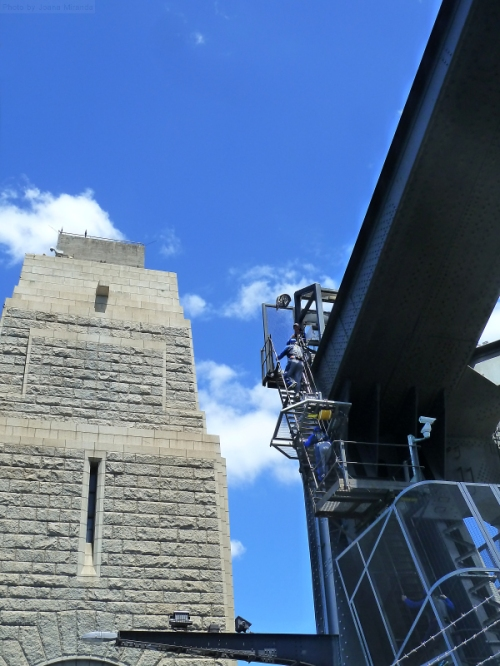 Two climbers ascending the staircase on the Sydney Harbor Bridge