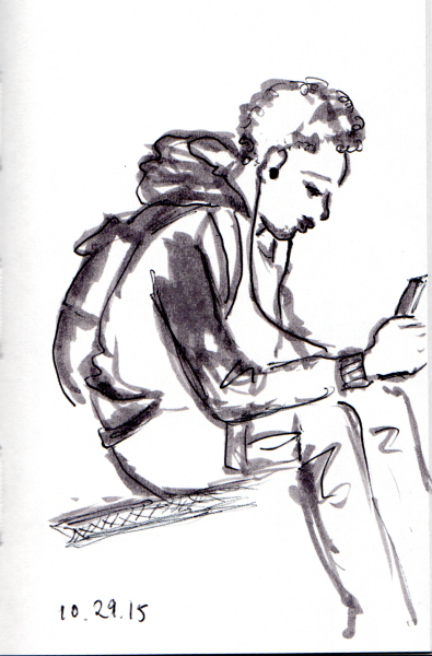 young man listening to music on the subway
