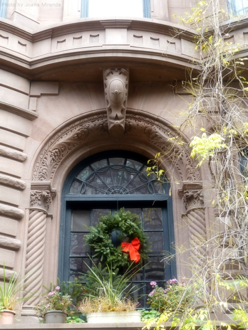 Brownstone with wreath on the window