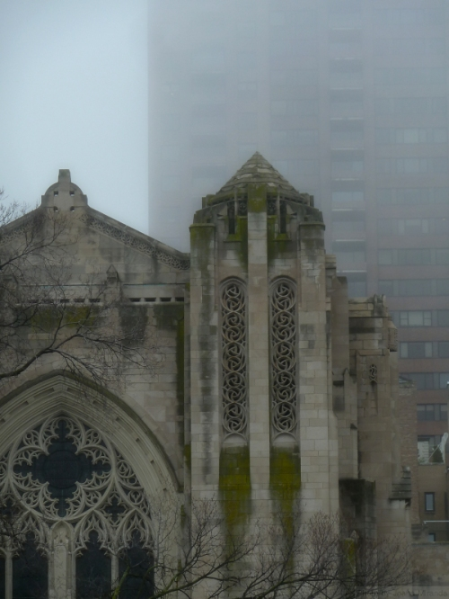 Upper East Side church and high rise in the fog