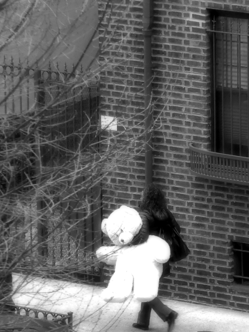 Woman carrying stuffed bear