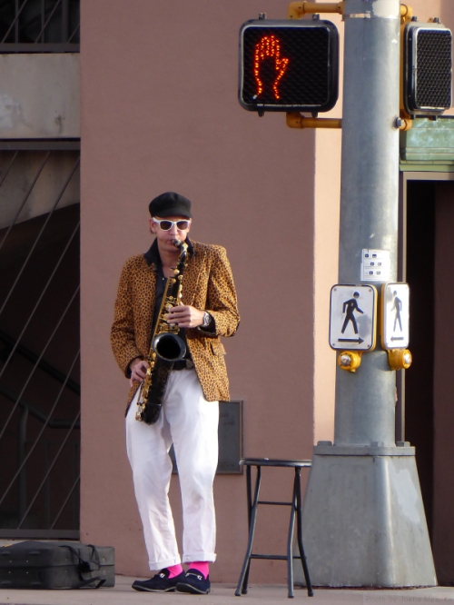 jazz saxophonist standing on a corner in Santa Fe