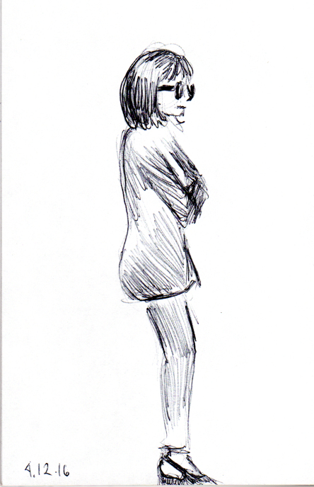 sketch of woman in glasses reading a subway billboard