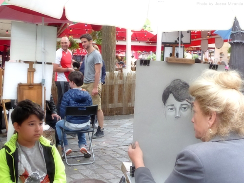 Boy being sketched in Montmartre