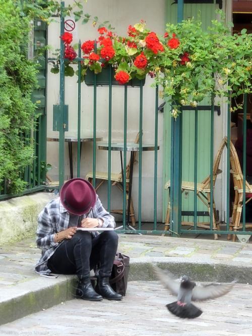 Boy in maroon hat sketching in Montmartre