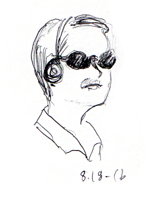 Man in sunglasses riding the subway